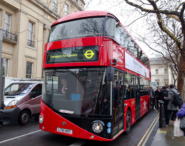 The bus arrives, with Transport for London commissioner Peter Hendy at the wheel