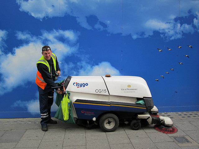 Street cleaner on Oxford Street by Andy Worthington