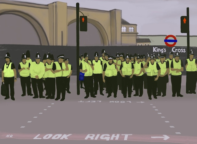 A line of police outside King's Cross station.