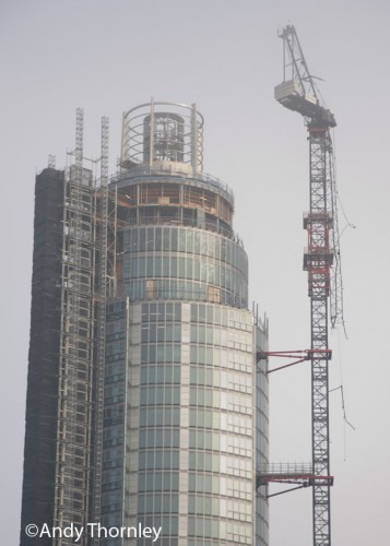 The low cloud briefly lifts to give a better view of the damage caused by the crane.