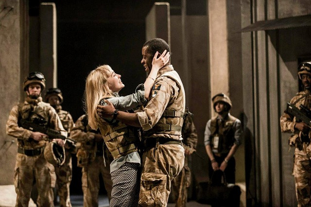 Olivia Vinall as Desdemona and Adrian Lester as Othello. Surely one of the morals of this story is: don't take your wife to a war zone