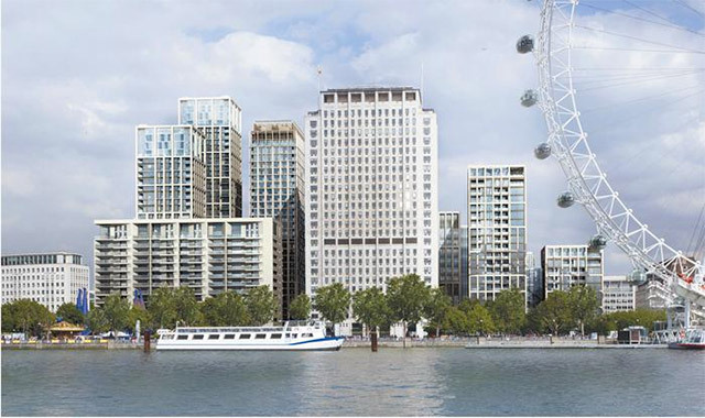 The view from across the river shows the scale of the development