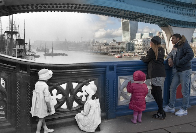 From the west side of Tower Bridge, George Davison Reid composed this photo looking out across the Upper Pool. This image is atypical of Reid's work, being a posed shot. The children appeared in other photos at different riverside locations. It has been suggested that some of the girls could be Reid's daughters.  Please note this image should only be used in the context of press publicity for the Streetmuseum app.