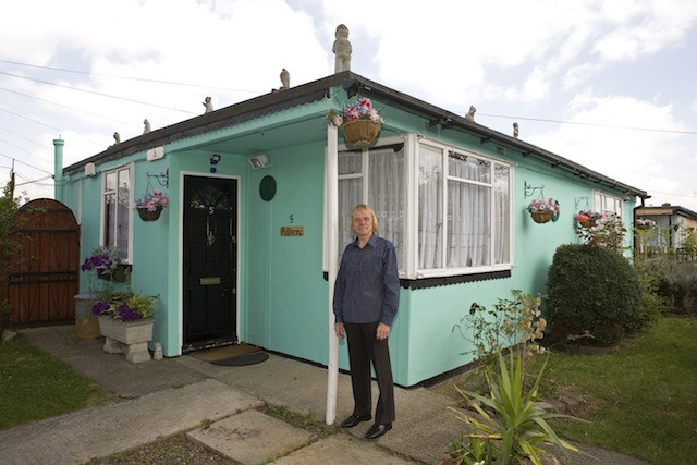 Jim in front of his prefab at the Excalibur estate in Catford, South London. He has been living in his prefab for 20 years and is fighting to save it as the Lewisham Council want to pull the prefabs down.