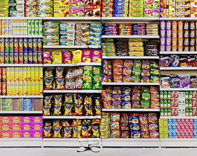 Liu Bolin, Hiding in the city - puffed food. Image courtesy of the artist and Scream