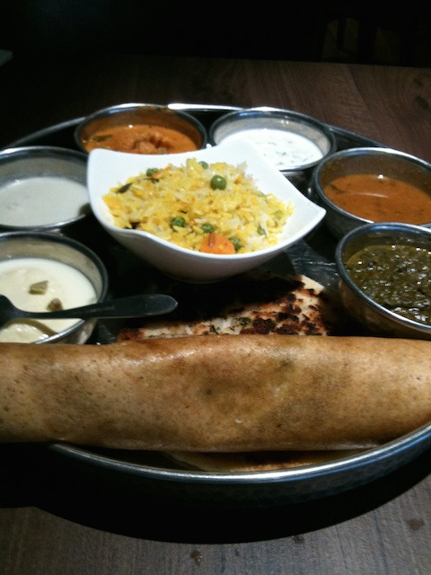 Thali with dosa and other dishes.