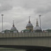 Rows of stalls can be seen on the eastern side of the bridge, with the domes of Cannon Street station and St Paul's in the background.