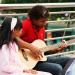 Guitar over the Thames by Stephanie Sadler