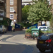 Google Street View image of the centre of London, roughly where the silver car on the right is parked.