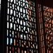 Gates of the British Library, and silhouette o opposite wall, by psyxjaw