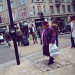 Lady in purple on Oxford Street, by Pierre Mallien