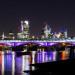 Blackfriars Bridge illuminated in purple, by Sascha Hauser
