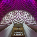 King's Cross station aglow in purple, by V